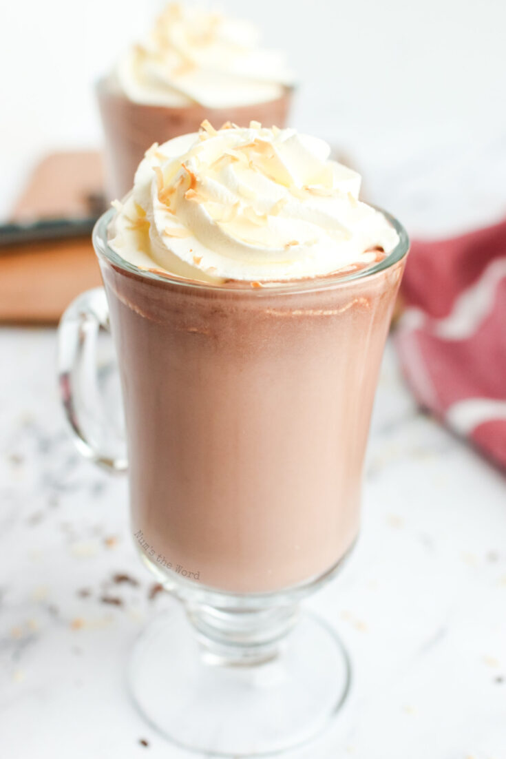 zoomed in image of 2 cups of hot chocolate ready to serve.
