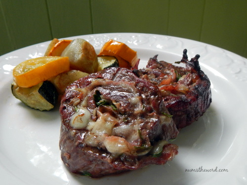 Grilled Stuffed Flank Steak - stakes on plate with cheese oozing out!