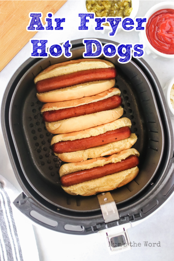 Main image for recipe of Air Fryer Hot Dogs. 4 Hot dogs in air fryer with buns.