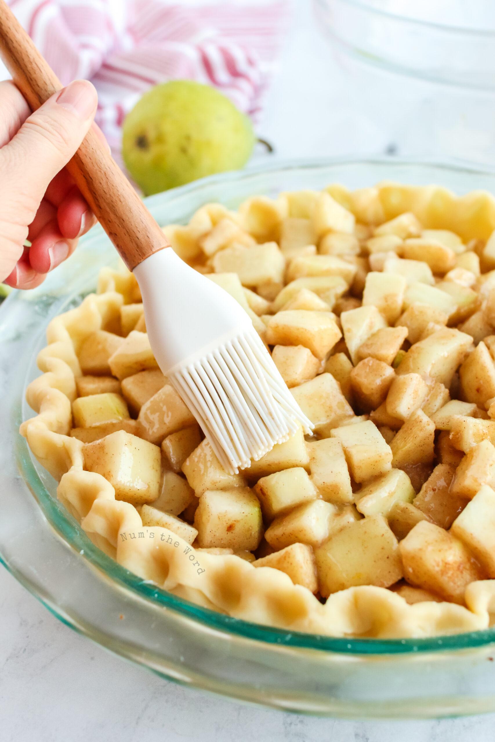lemon juice spread over top of pears