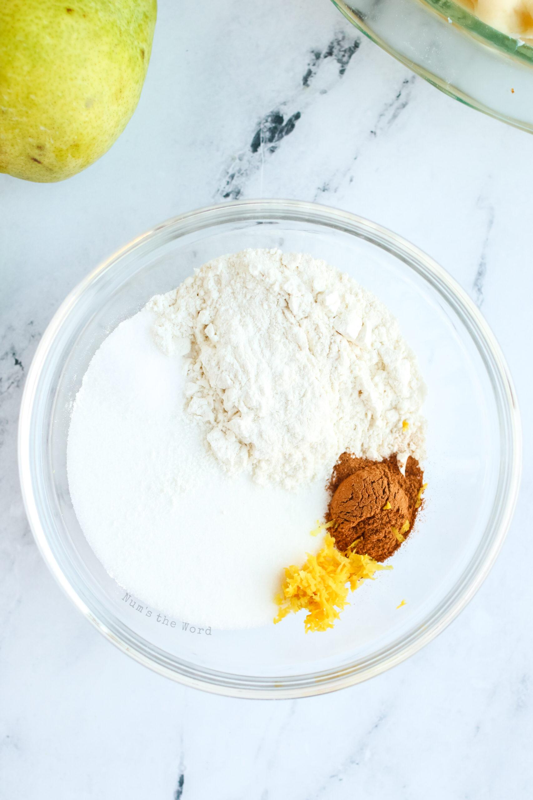 sugar, flour, salt, cinnamon and lime zest added to a bowl