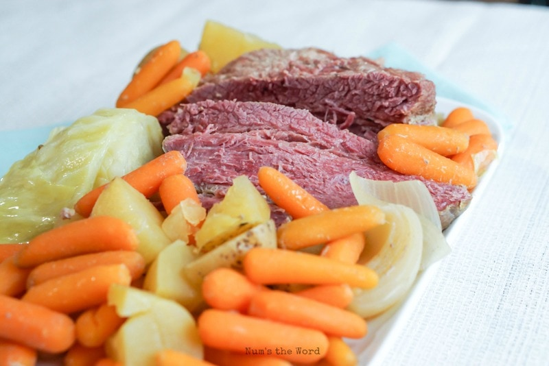 Corned Beef & Cabbage - Corned beef & cabbage with carrots and potatoes on platter - looking from the side down angle