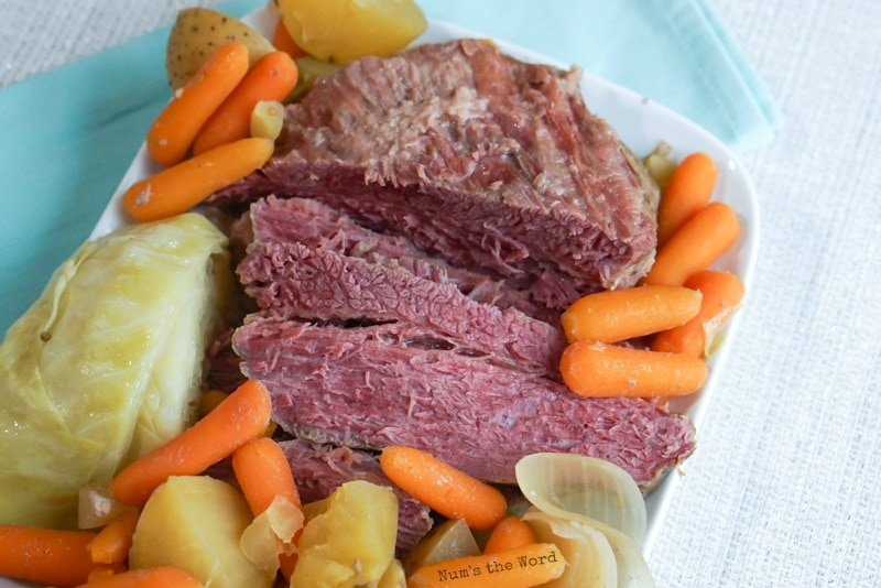 Corned Beef & Cabbage - Corned beef and vegetables on platter looking from the top down. Corned beef is sliced