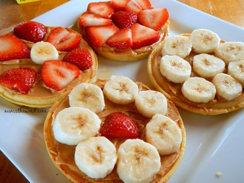 Eggo Waffle Fruit Pizza - waffles topped with fresh fruit - bananas and strawberries