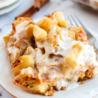 large slice of apple fritter casserole on plate side view.
