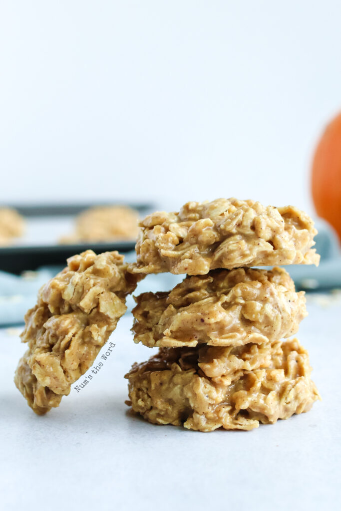 No Bake Pumpkin Spice Cookies - 3 cookies stacked on top of each other with one leaning on the side