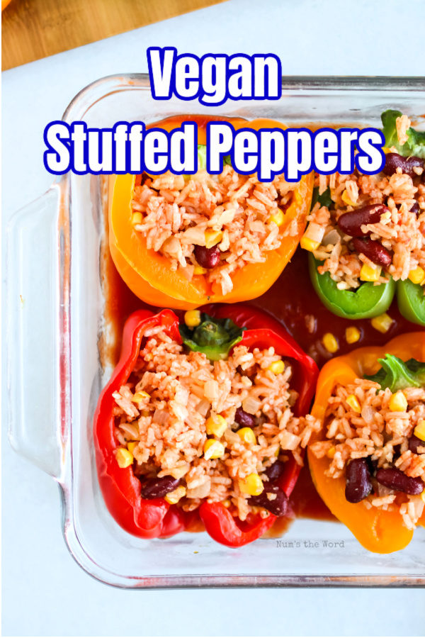 main image for recipe of vegan stuffed peppers in a casserole dish ready to be baked.