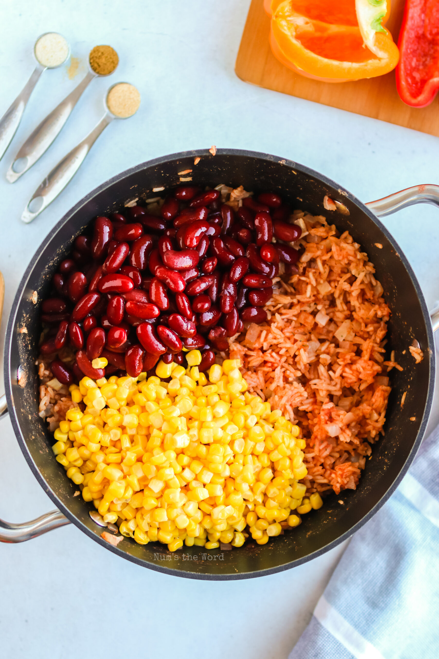 Rice is cooked with beans, corn and seasonings added.