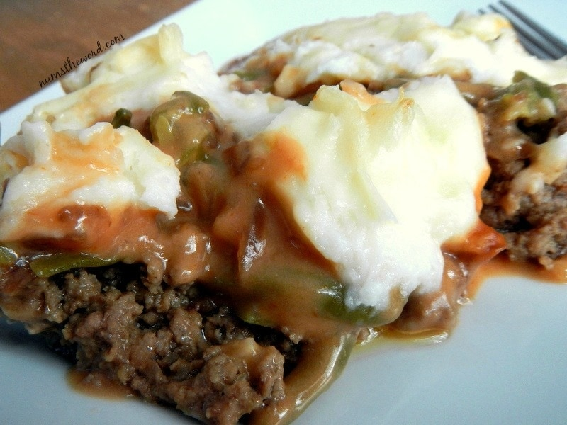 Salisbury Steak Casserole - topped with green beans, sauce and mashed potatoes