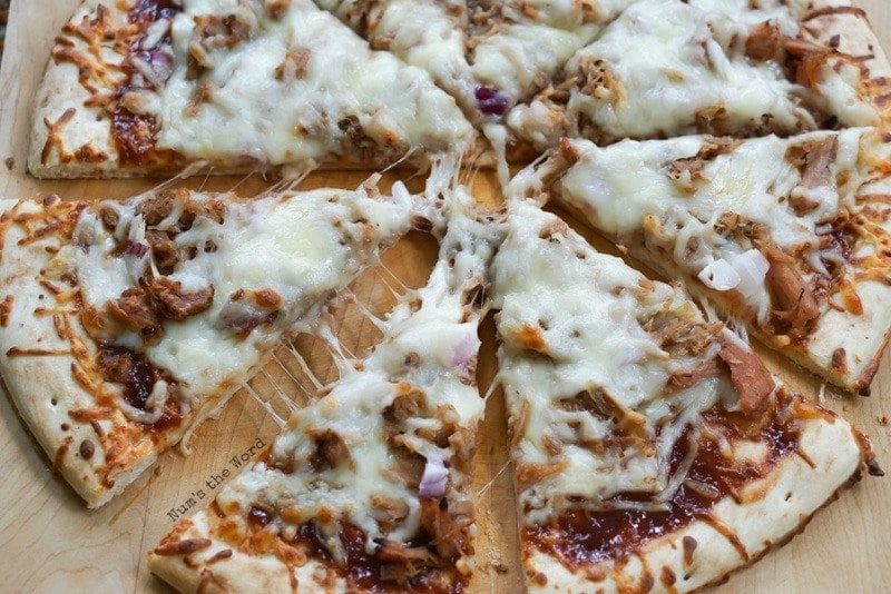Barbecue Pulled Pork Pizza - wide view of sliced pizza ready to be eaten.