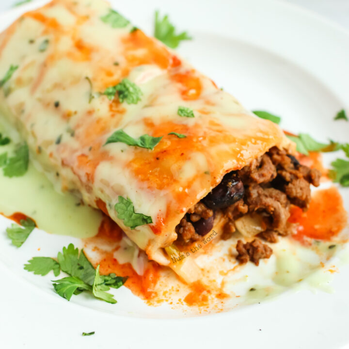 burrito on plate cut in half showing meat filling