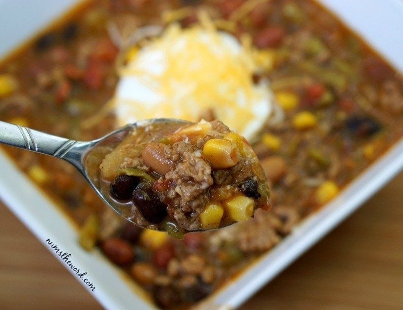 8 Can Taco Soup - soup in a bowl with a spoonful in front of camera lens.