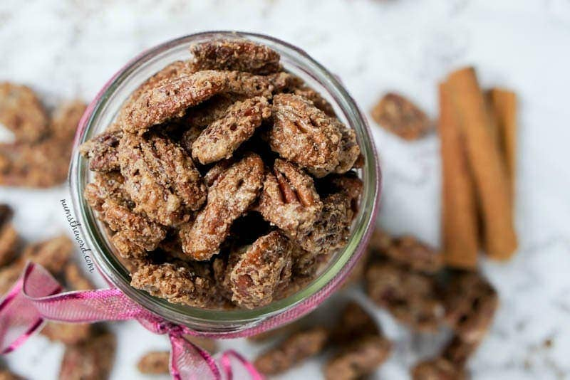 Cinnamon Pecans - Top angle view of pecans in a glass jar