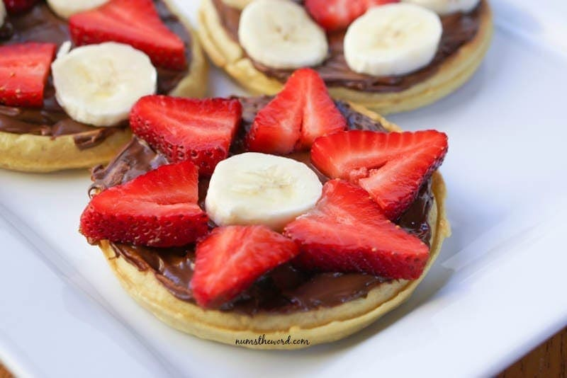 Eggo & Nutella Breakfast Pizzas - close up shot of waffles with nutella and fruit