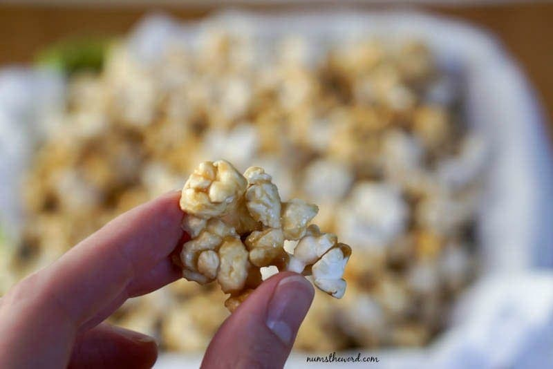 Microwave Caramel Corn - Holding up a hunk of caramel corn