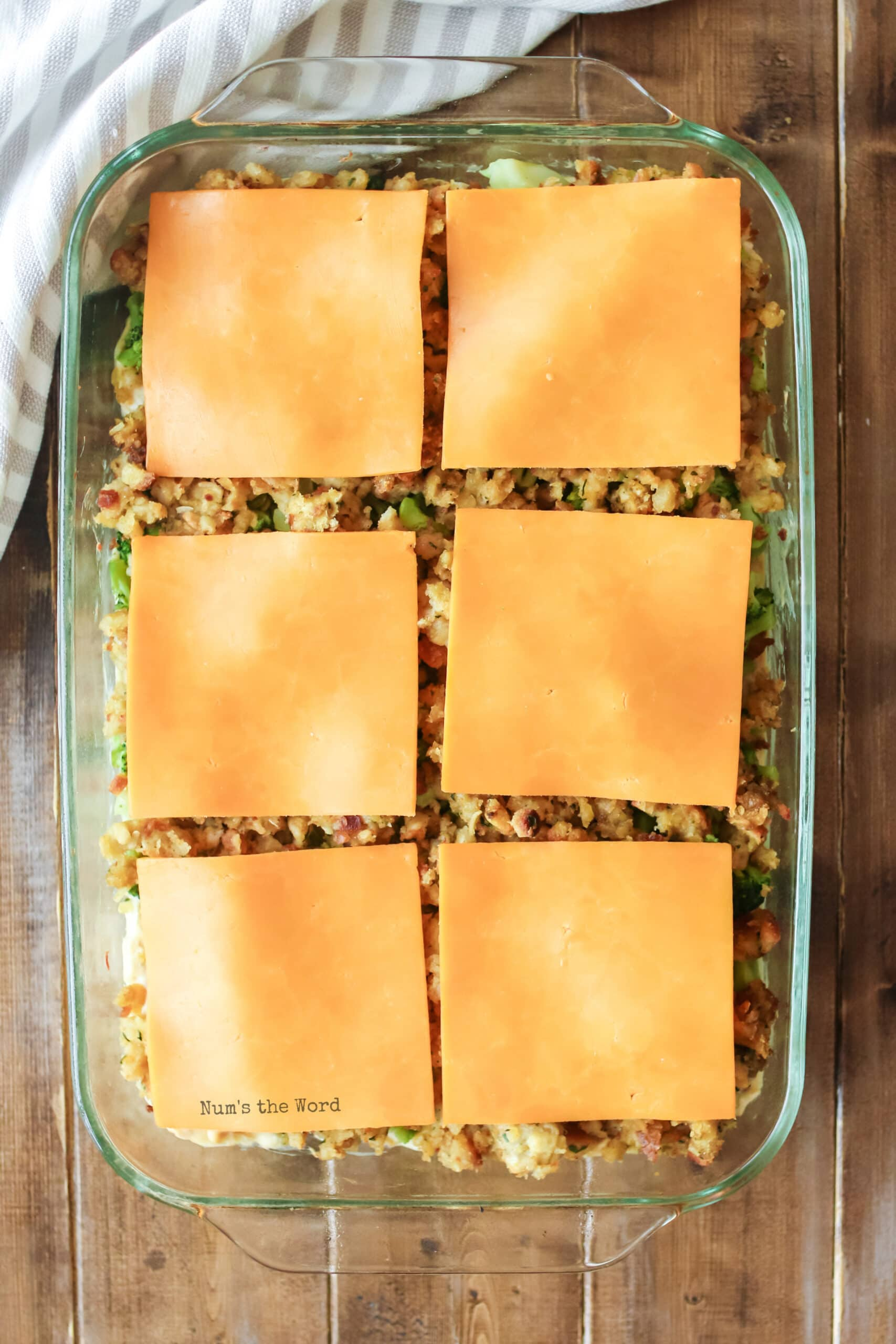 Turkey Casserole - cheese slices placed on top of stuffing in casserole dish.