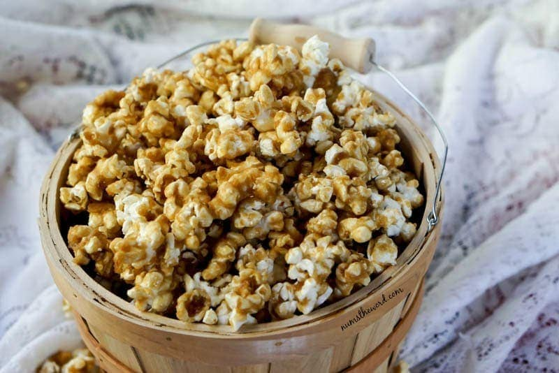 Coconut Caramel Corn - Caramel corn in basket looking down and at an angle