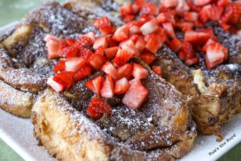French Toast Casserole - french toast on platter with strawberries and powdered sugar