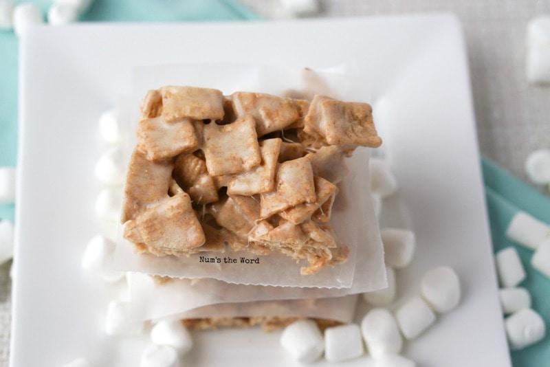 Churro Marshmallow Treats - Churro treats stacked on a plate