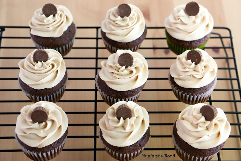 Peanut Butter Frosting on cupcakes on cooling rack