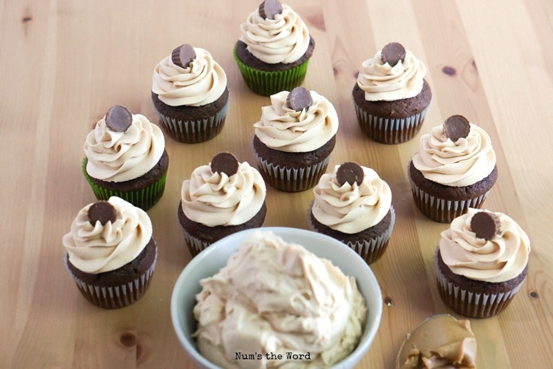 Peanut Butter Frosting in bowl with cupcakes in background