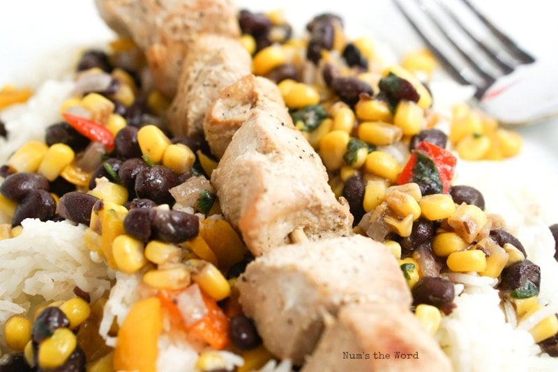 Mexican Chicken Kabobs - different angle of kabob over rice & mexican salsa