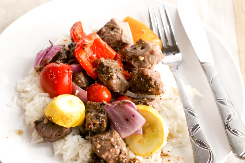 Marinated steak kabobs off the skewer over rice
