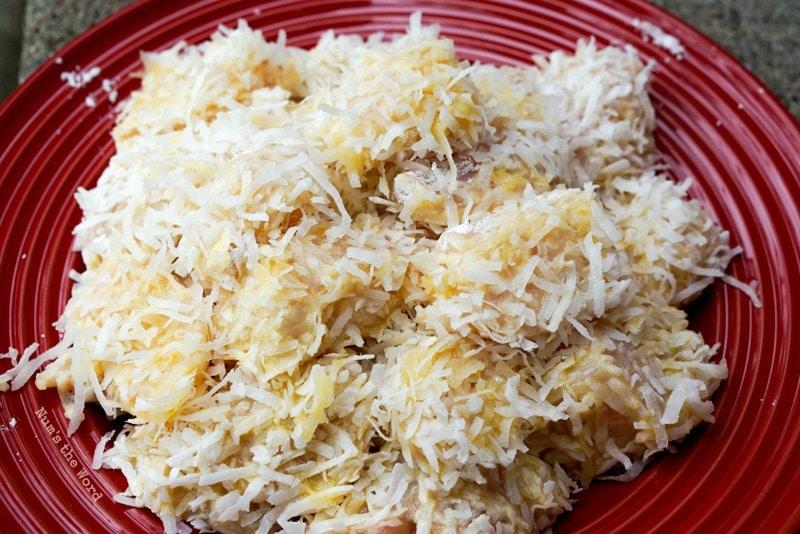 Crispy Coconut Chicken - plate full of uncooked coconut chicken