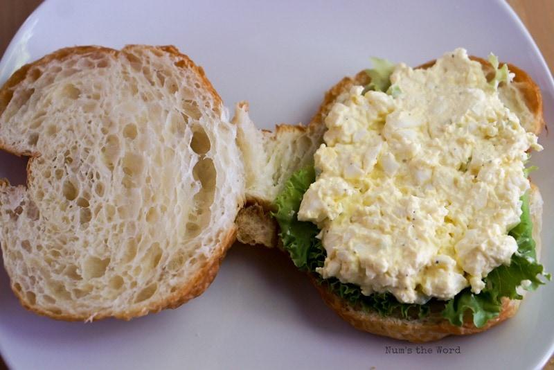 Deluxe Egg Salad - Egg salad place on lettuce on croissant