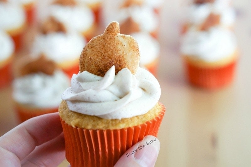 Pumpkin Cupcakes - Close up of pumpkin pie cupcake with frosting and pie crust cookie