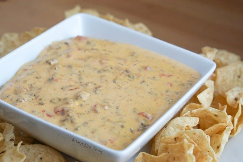 Crock Pot Mexican Sausage Dip - side angle of bowl full of dip with chips surrounding