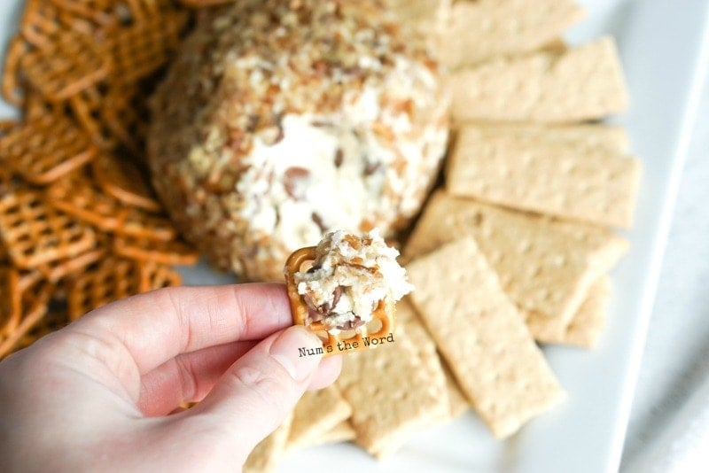 Chocolate Chip Cheese Ball - Cheese ball smeared on a pretzel