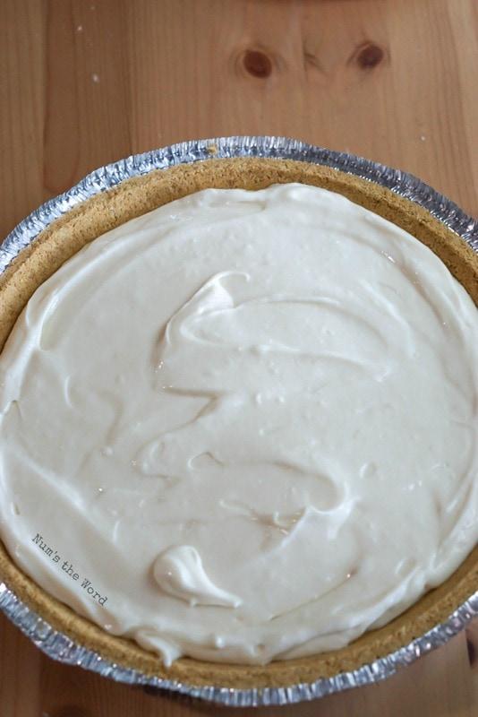 No Bake Lemon Cheesecake - cheesecake mixture poured into a prepared graham cracker crust