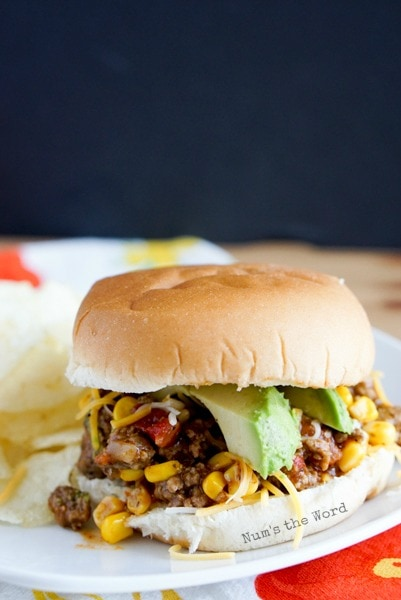 Mexican Sloppy Joes - sloppy joes on hamburger bun topped with cheese and avocado