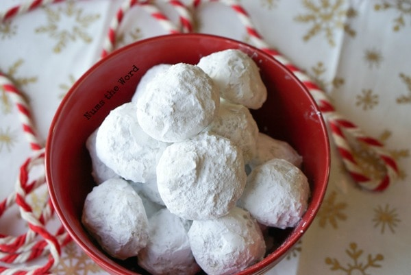 Surprise Snowball Cookies - bowl full of cookies hiding their secret surprise inside.