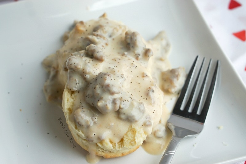 Homemade Sausage Gravy - 1 biscuit, sliced open and gravy poured on top