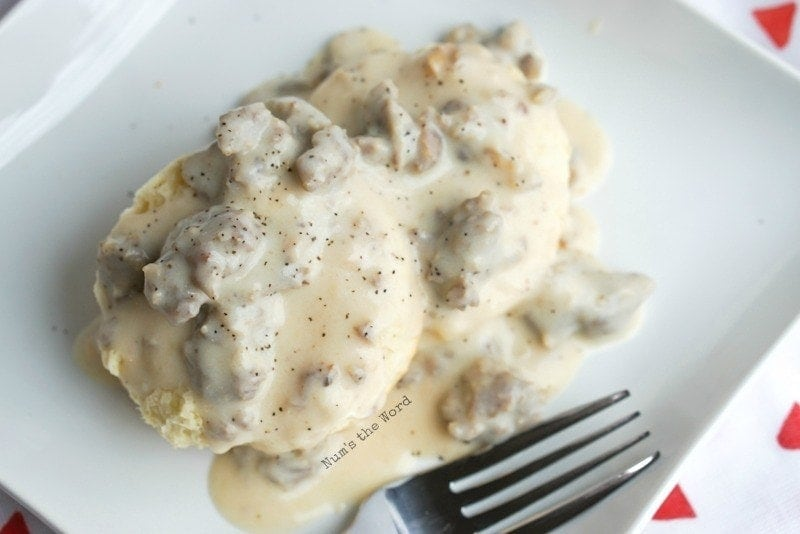 Homemade Sausage Gravy - photo taken from top and side of gravy on biscuits