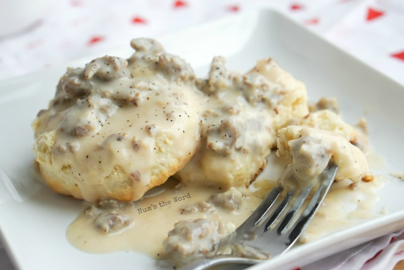 Homemade Sausage Gravy - side view of gravy on biscuits