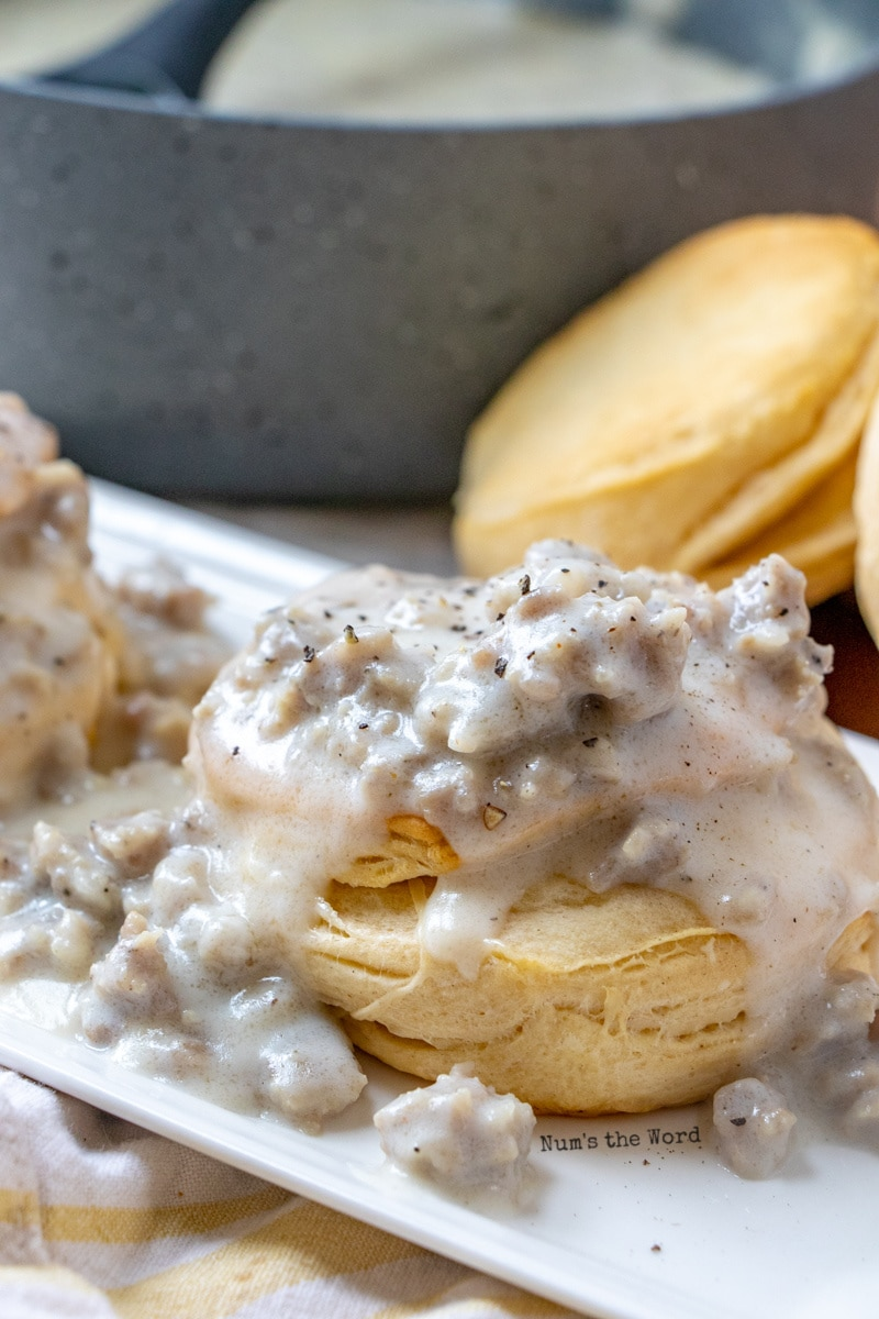 best sausage gravy recipe - close up image of biscuits and gravy on plate