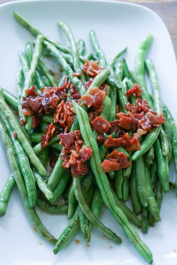 Brown Sugar & Bacon Green Beans - green beans and candied bacon plated up on serving tray.