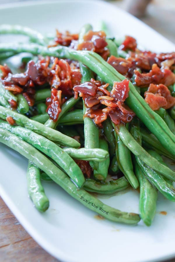 Brown Sugar & Bacon Green Beans - side view of bacon and green beans on plate