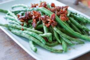 Brown Sugar & Bacon Green Beans - zoomed out view of cooked green beans on plate