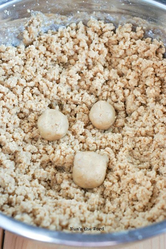 Peanut Butter Cup Truffles - 3 round balls placed onto of graham cracker mixture.