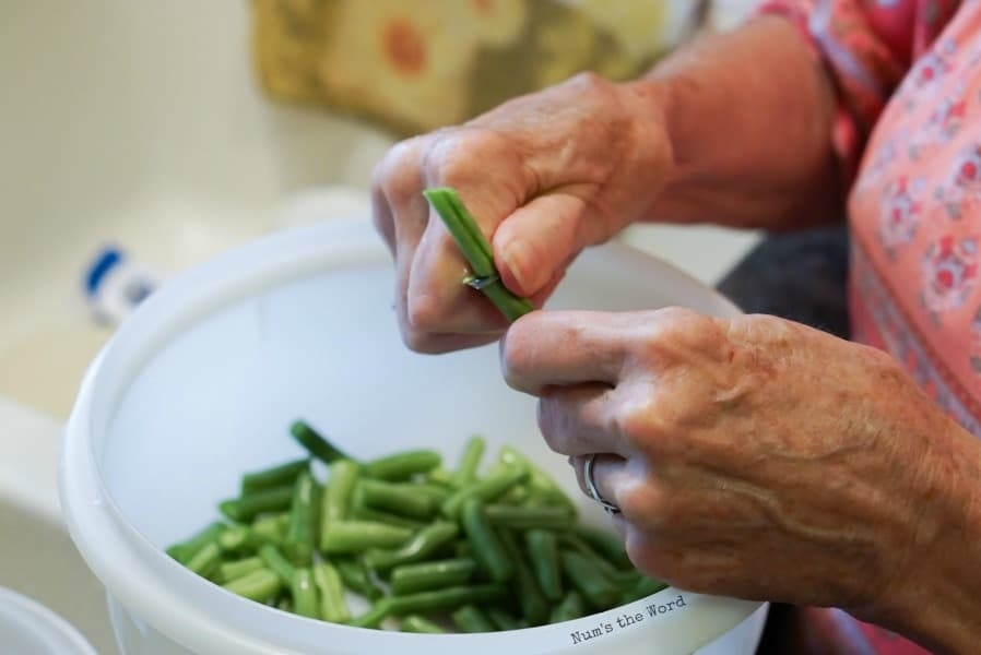 Trimming green beans with knife