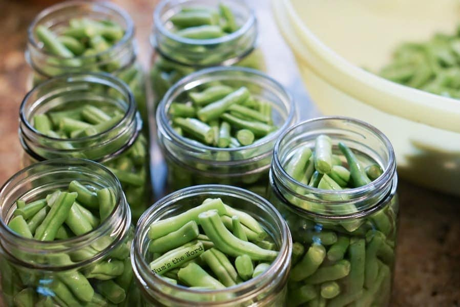 green beans in open jars