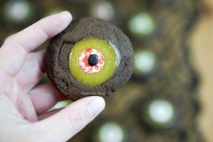 Monster Eye Ball Cookies - single cookie up close in hand to show size.