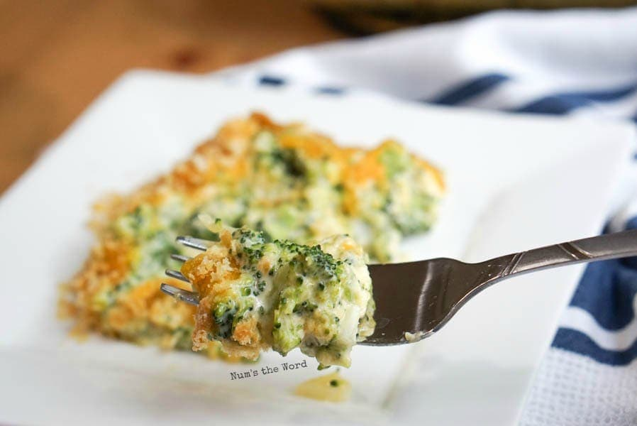 Cheesy Broccoli Casserole - fork held up full of casserole ready to be eaten.