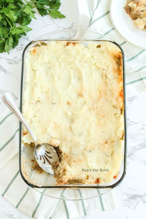 Salisbury Steak Casserole Recipe - a scoop of casserole removed from oven with a scoop removed