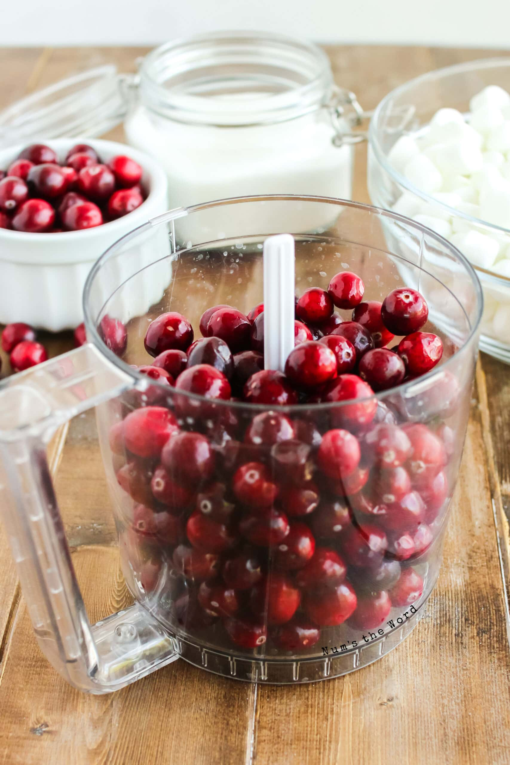 fresh cranberries in a food processor.