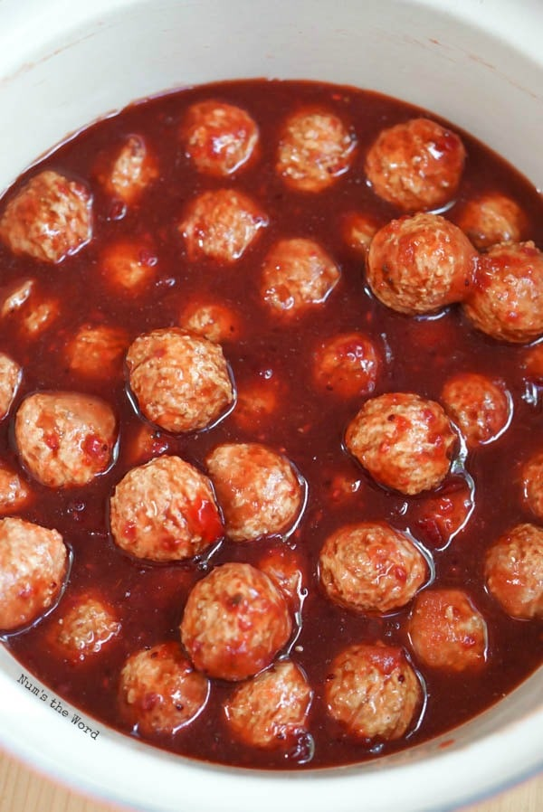 Chili Cranberry Meatballs - meatballs added to cranberry mixture.